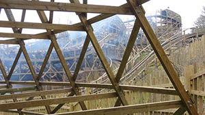 Looking through the wooden ride structure towards the top of the lift hill