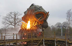 Huge flames shoot out of the Wicker Man's shoulders