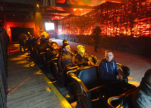 The Wicker Man station is lit in flaming oranges and yellows