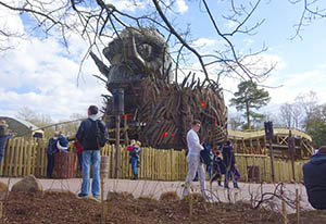 The Wicker Man theming element towers over the ride area