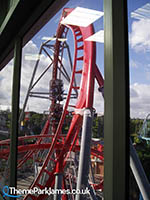 G Force's train ascends the lift hill, as seen from a station window