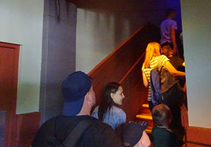 Inside the house, the queue takes riders upstairs to the preshow