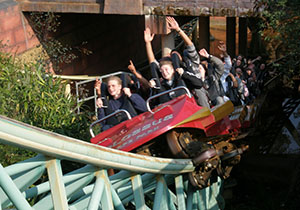 A Colossus train emerges from underneath the rollercoaster's shop