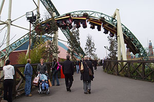 The rollercoaster track interacts with bystanders at multiple points during the ride