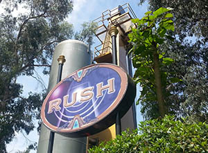 Rush ride sign, with one of the ride's two giant air tanks behind