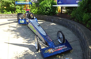 A real dragster car on display outside the ride exit