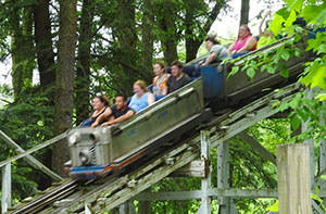Riders zoom down one of Blue Streak's hills