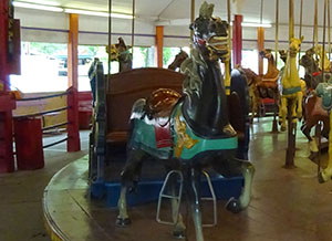 One of the carousel's two horse-drawn chariots