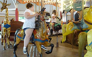 Today's guests get a ride on the century old carousel
